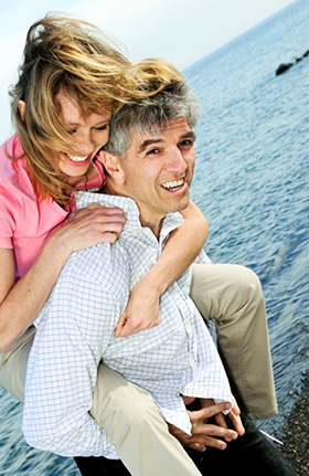 An older couple after having a dental implant procedure