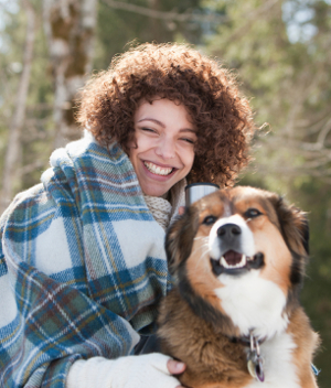 A woman and her dog focus on living a happy, healthy lifestyle